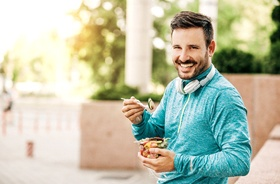 Man enjoying salad with help of dental implants
