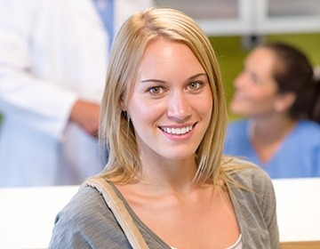 Smiling dental patient in reception area