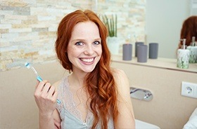 Smiling woman holding toothbrush