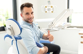 thumbs up from dental patient