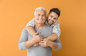 Father and adult son, both possible candidates for dental implants