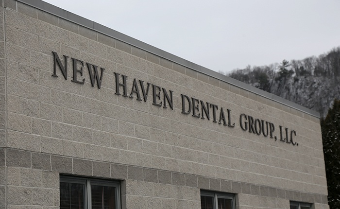 New Have Dental Group sign on building