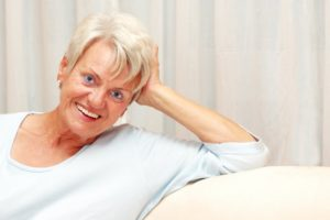 Senior woman benefitting from modern evolution of dentures